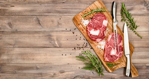 Raw meat Ribeye Steak with herbs and spices Royalty Free Stock Images