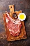 Raw meat Ribeye Steak with spices Stock Photos