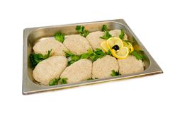 Raw meat rissoles. On the steel tray Stock Image