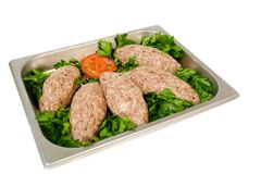 Raw meat rissoles. On the steel tray Stock Photos