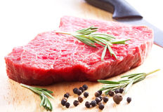 Raw meat with rosemary Stock Image