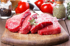 Raw meat with rosemary. And vegetables Stock Photo