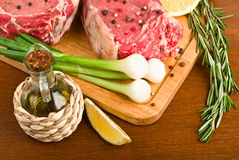 Raw meat with rosemary closeup Stock Photos