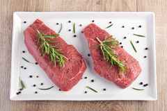 Raw meat with rosemary Royalty Free Stock Image