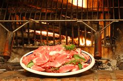 Raw meat with Rosemary ready to be cooked on the grill Stock Photography