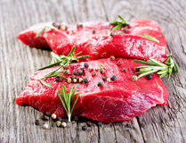 Raw meat with rosemary Royalty Free Stock Photos