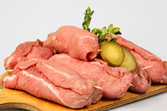 Raw meat roulade. Roulade with raw meat on board Stock Image
