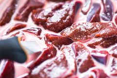 Raw meat in the sauce Stock Image