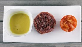 Raw meat with sauce and tomato Stock Image