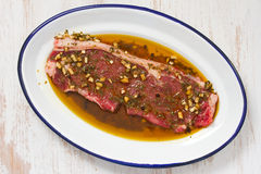 Raw meat in sauce Stock Image