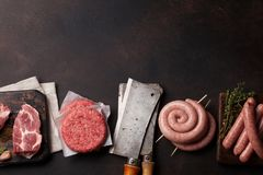 Raw meat and sausages Royalty Free Stock Images