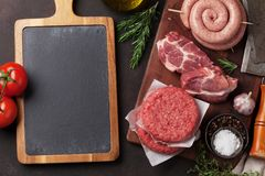 Raw meat and sausages Stock Images