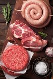 Raw meat and sausages. Raw meat, cutlet and sausages. Top view Stock Photos