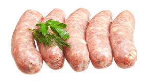 Raw meat sausages with greens Stock Images