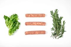Raw meat sausages isolated on white background.  stock image