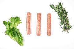 Raw meat sausages isolated on white background.  stock photography