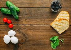 Raw meat in seasoning, olives, herb and eggs Royalty Free Stock Photography