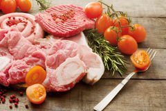 Raw meat selection over rough wood Royalty Free Stock Images