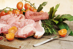 Raw meat selection over rough wood Royalty Free Stock Photography