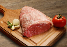 Raw meat selection on wooden cutting board. Royalty Free Stock Photos