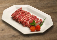 Raw meat selection on wooden cutting board. Royalty Free Stock Images