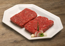 Raw meat selection on wooden cutting board. Stock Photography