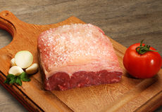 Raw meat selection on wooden cutting board. Royalty Free Stock Photography
