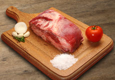 Raw meat selection on wooden cutting board. Stock Photo
