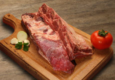 Raw meat selection on wooden cutting board. Stock Images