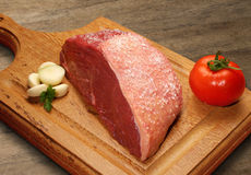 Raw meat selection on wooden cutting board. Stock Photos