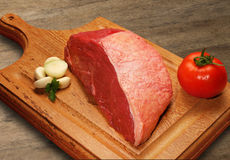 Raw meat selection on wooden cutting board. Royalty Free Stock Photo
