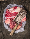 Raw Meat set for soup with vintage cleaver on dark background. Top view stock photo