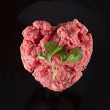 Raw meat in shape of heart royalty free stock photography
