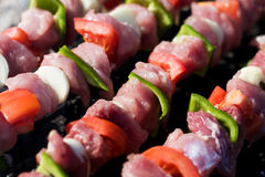 Raw meat skewers stock photos