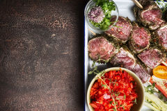 Raw Meat skewers preparation with fresh gut vegetables on rustic background, top view Royalty Free Stock Image