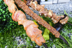 Raw meat on skewers of vegetables Royalty Free Stock Images