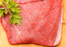 Raw meat slice on board Stock Photo