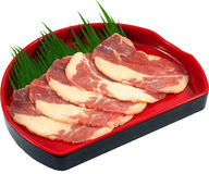 Raw Meat Slice. The Isolation raw food ingredient in the decorated container royalty free stock photo