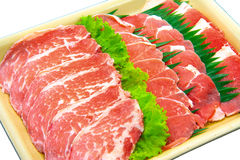 Raw Meat Slice. The Isolation raw food ingredient in the decorated container royalty free stock photography