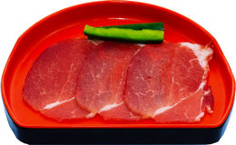 Raw Meat Slice. The Isolation raw food ingredient in the decorated container stock photos
