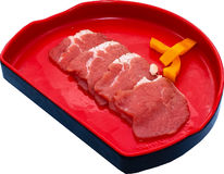 Raw Meat Slice. The Isolation raw food ingredient in the decorated container royalty free stock image