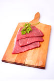 Raw meat slices on board. With parsley Royalty Free Stock Photography