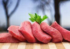 Raw Meat slices, close-up view. Meat raw slices group background market shop Stock Photos