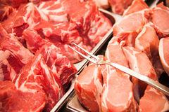 Raw meat slices. Variety of raw meat slices in a butcher shop Stock Images