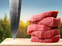 Raw Meat slices on wooden background. Meat raw slices group background market shop Stock Photo