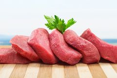 Raw Meat slices on wooden background. Meat raw slices group background market shop Stock Images