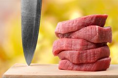 Raw Meat slices on wooden background. Meat raw slices group background market shop Royalty Free Stock Photo