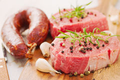Raw meat with smoked sausage, pepper and garlic Stock Photos