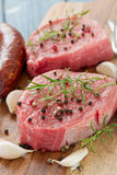 Raw meat with smoked sausage, pepper and garlic Stock Image