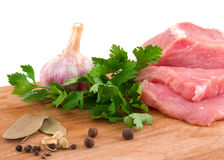 Raw meat and spice. On a white background Royalty Free Stock Image